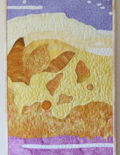 <p>Beach Strata 2013</p>  <p>Experimental quilt which emerged from an abstract watercolour painting following a Katie Pasquini Masopust  workshop.  It reminded me of sand dunes after the tide goes out.</p>