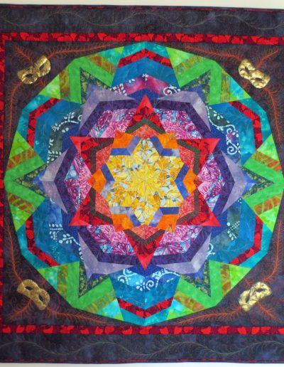 <p>Carnival Kaleidoscope 2016</p>  <p>I love colour and the organised chaos of kaleidoscopes.  The relationship of colours around the colour wheel combined with a kaleidoscope, create my colour carnival.</p>  <p>The Quilting Show Glasgow 2016  Bronze award winner –   Themed Quilts  –  Carnival Colours</p>