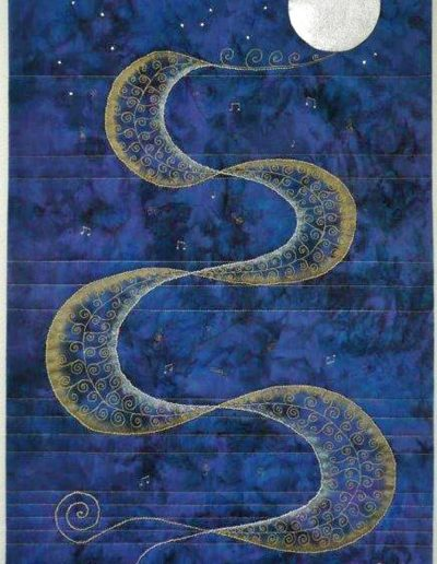 <p>Gold &#038; Silver Waltz</p> <p>Juried into the CQ &#8216;Elements&#8217; Challenge Festival of Quilts 2015</p> <p>I found my &#8216;Elements&#8217; in Franz Lehar&#8217;s Gold and Silver Waltz. I adapted Libby Lehman&#8217;s ribbon design to portray the dancers swaying and twirling to the music. The couple (treble clef and bass clef) dance from the music lines around the floor and out into the starry moonlight night.