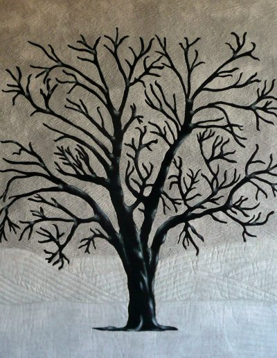 <p>Winter by Nancy Smith <p>A large single tree growing in the countryside is a truly majestic sight.   I decided to stitch this one on a winter&#8217;s day which might be the reason for the colour scheme but my aim was to make the tree the strong player in the design.